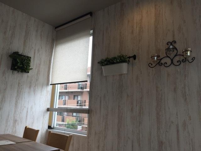 708オステリアヤンバル店内の壁面